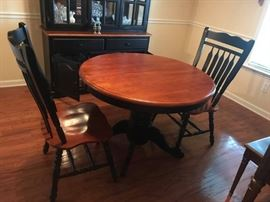 #1	round black and wood pedistal table w 4 chairs 42x30	 $175.00