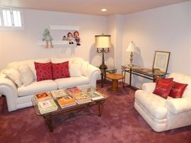 Couch, large upholstered chair, coffee table, sofa table, end table, and accessories