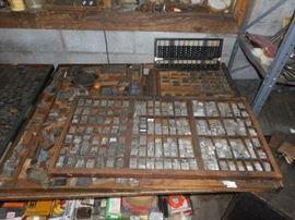 Printers drawers with metal print blocks