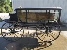 Antique funeral carriage with casket rollers and wicker basket