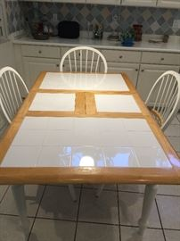 Kitchen table with tile inlay with 4 chairs and leaf
