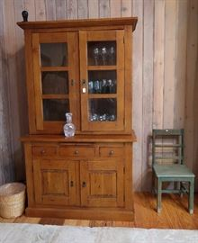 Primitive pine cupboard and painted green chair