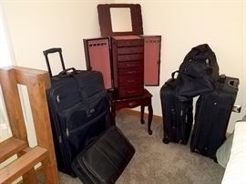 Luggage. Jewelry armoire