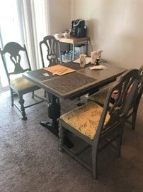 vintage distressed gray with/yellow print Paris theme- dining table and chairs - table can expand to twice the size.  Crate and Barrel Butcher block table