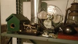 Old fan, antique scale, railroad lantern and interesting bookends
