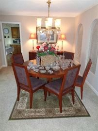 round table, 6 chairs and lots of crystal