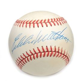 "Eddie Mathews Signed Rawlings NL Baseball COA: A (HOF) Eddie Mathews signed Rawlings American League (White Pres.) baseball. Eddie signed this baseball on the ""sweet spot"" area in blue ink pen. The autograph is bold and smudge free and has been professionally authenticated by SGC with hologram affixed to the baseball. Please note, there is an accompanying SGC certification card enclosed. A member of the National Baseball Hall Of Fame, Eddie is a twelve- time All-Star. Elected to the Hall Of Fame in 1978, he passed away in 2001. The signed baseball is housed in a round protective holder without the base."