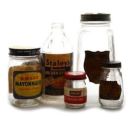 "Six Vintage Kitchen Product Containers: An assortment of six empty vintage jars/can of everyday products. The jars are: ""Honey Grove Sweet Pickles""; ""Drum Pure Preferred Mustard"", the lid has manufactured holes; ""Armour Bouillon Cubes""; ""Kraft Mayonnaise Kitchen Fresh""; and ""Staley's Sweetose Golden Syrup"" (missing the lid); The can is an ""MacLaren's Imperial Cheddar Club Cheese Sharp made by Kraft""."