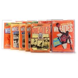 "Wheaties Cereal Boxes, Jordan, McGwire, Griffey, Russell, and More: An assortment of ten Wheaties cereal boxes advertising star sports athletes. The boxes portray a colorful image of a star player of the front side with career statistics and achievements on the backs. Enclosed in protective acrylic cases, the athletes include Mark McGwire ""70 Home Runs 1998,"" Ken Griffey Jr. ""Welcome Home,"" Arnold Palmer ""A Golfing Legend,"" Bill Russell ""Boston Celtics,"" Michael Jordan ""Quotes,"" and ""Free Poster Offer."" Finally, there are four boxes honoring the greats of Major and Negro League Baseball including Babe Ruth, Lou Gehrig, Willie Mays, and a trio of players such as Josh Gibson, Satchel Page, and Cool Papa Bell."
