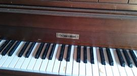 Schuerman stand up piano.