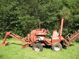 Ditch witch model 2300 (not running).With A 220 Backhoe.  Starting bid $1500.00