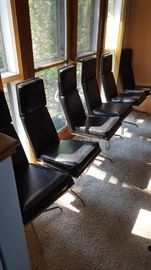Set of 8 MCM swivel dining chairs