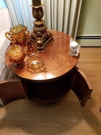 Formal round all-wood end table. Manufacturer unknown. Asking $95.00 for two.