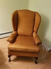 Claw foot, rust colored armchair from Mazor Classic. Asking $55.00.