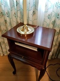 Mahogany side table with pull-out drawer, sitting on cabriole legs. Asking $28.00.