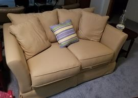 """Tan fabric colored love seat, 62"""" x 35"""" x 23"""". Two available. Asking $59.00 each."""
