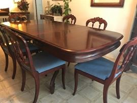 Cherry wood dining table with two leaves and six chairs. Beautifully carved design and in impeccable condition (approx. 1940s) $1000