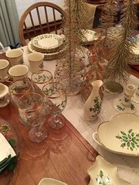 Many pieces of Lenox Holiday China: Dinner Plates, Salad Plates, Mugs, Covered Casserole Dishes, Christmas Tree Dish, Divided Dish, Handled Serving Dishes, Stemware, Candlesticks, Vase, Cream and Sugar and more!  The majority are new with box.
