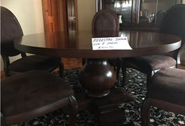 Wood pedestal dining table with 5 padded chairs-$400.