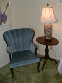 nice upholstered chair and vintage tilt top table