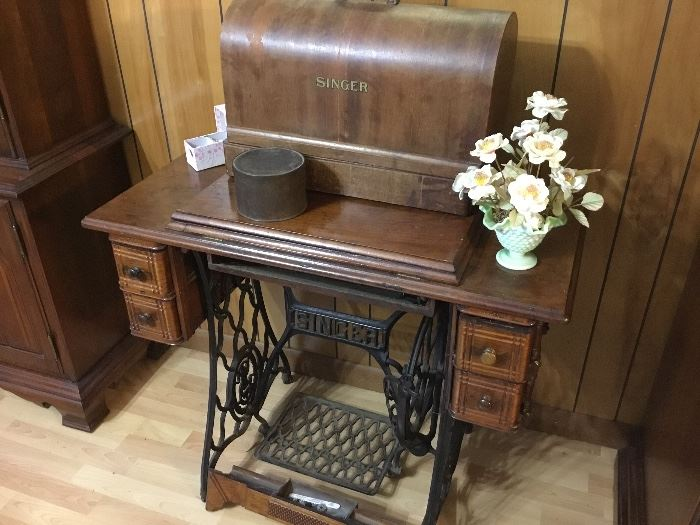 Vintage Singer treadle machine and boxed machine