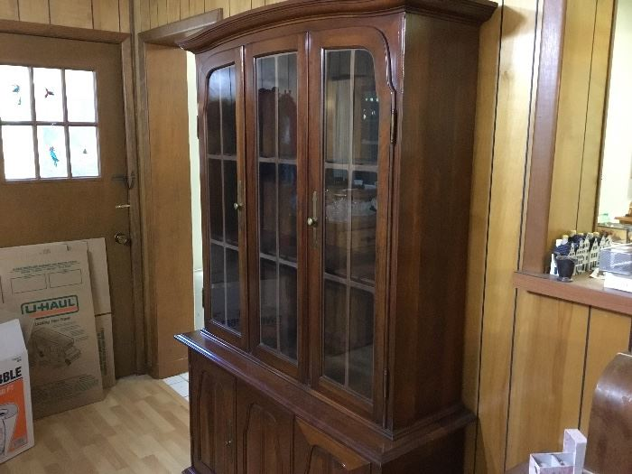 Cherry China cabinet with storage in bottom