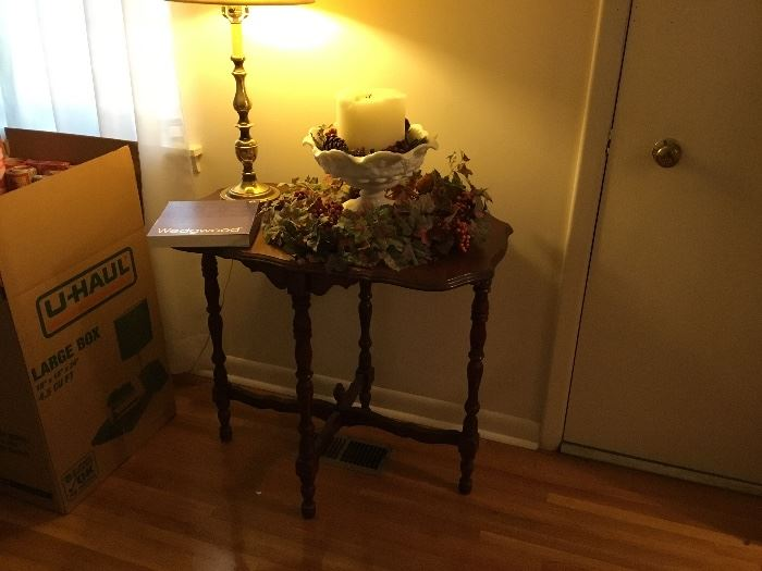 Oval vintage table with decor and lamp