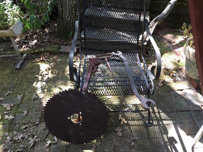 Old saw blade and another wrought iron chair
