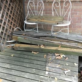 More wood on patio along with 2 vintage metal chairs