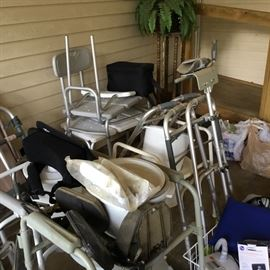 Various medical items including bath benches, walkers, canes, potty chair & more