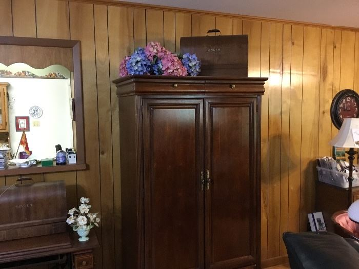 Armoire - vintage sewing machine in case on top