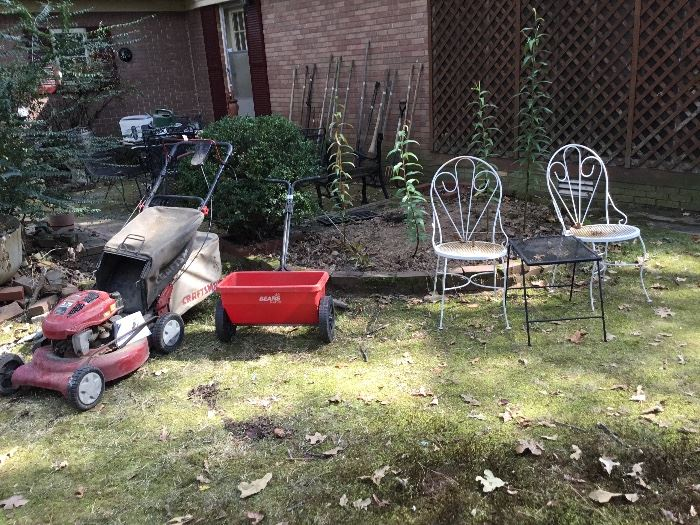 Lawn mower (works), spreader, great metal chairs & a table - more tools in background