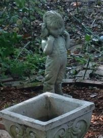 There are several statues and planters.