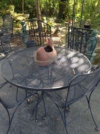 """Round table; 4 matching chairs (The table is a different """"weave."""")"""