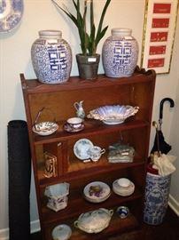 Book shelf, ginger jars, and blue & white umbrella holder