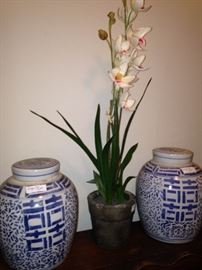 Ginger jars and artificial orchids