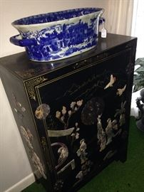 Black Asian 2-door chest featuring soapstone ladies, flowers, and birds; blue & white planter
