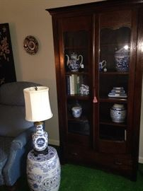 Blue & white garden stool and lamp; antique display cabinet with blue & white decor
