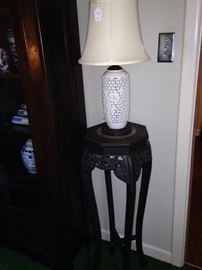 Plant stand; one of two white riticulated lamps