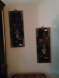 Two of four Asian panels with soapstone