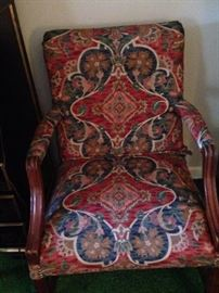 One of two matching upholstered arm chairs