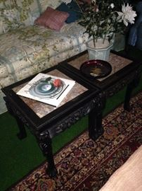 Two carved Asian style tables with marble top inserts