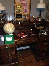 Roll top desk, globe, lamps, and other decor