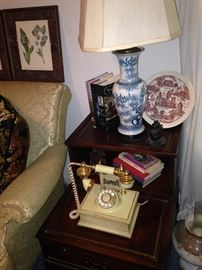 Two-tiered leather top side table; unique vintage telephone