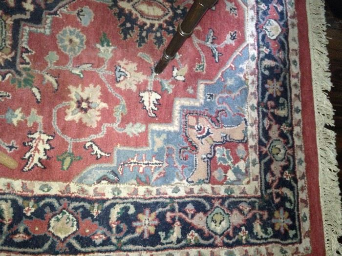 64 inches x 96 inches rug in reds and blues