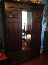 A stunning mirrored antique armoire