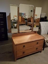 Antique two drawer chest with tri fold mirror. Beautiful piece of Americana furniture.
