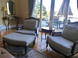 Pair of oversized armchairs, each has an ottoman