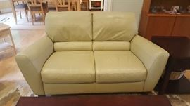 Pewter/light green leather loveseat   $350