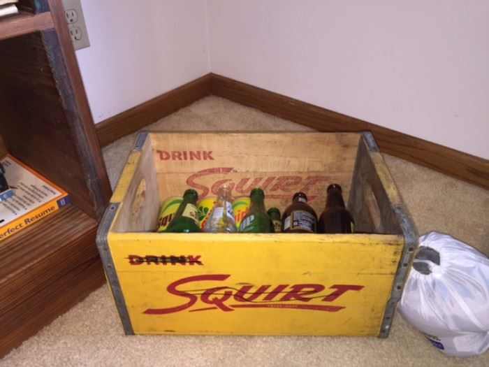 Vintage squirt crate with bottles, etc.